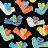 Handmade bird magnets by the potters of Lorraine Oerth & Co.