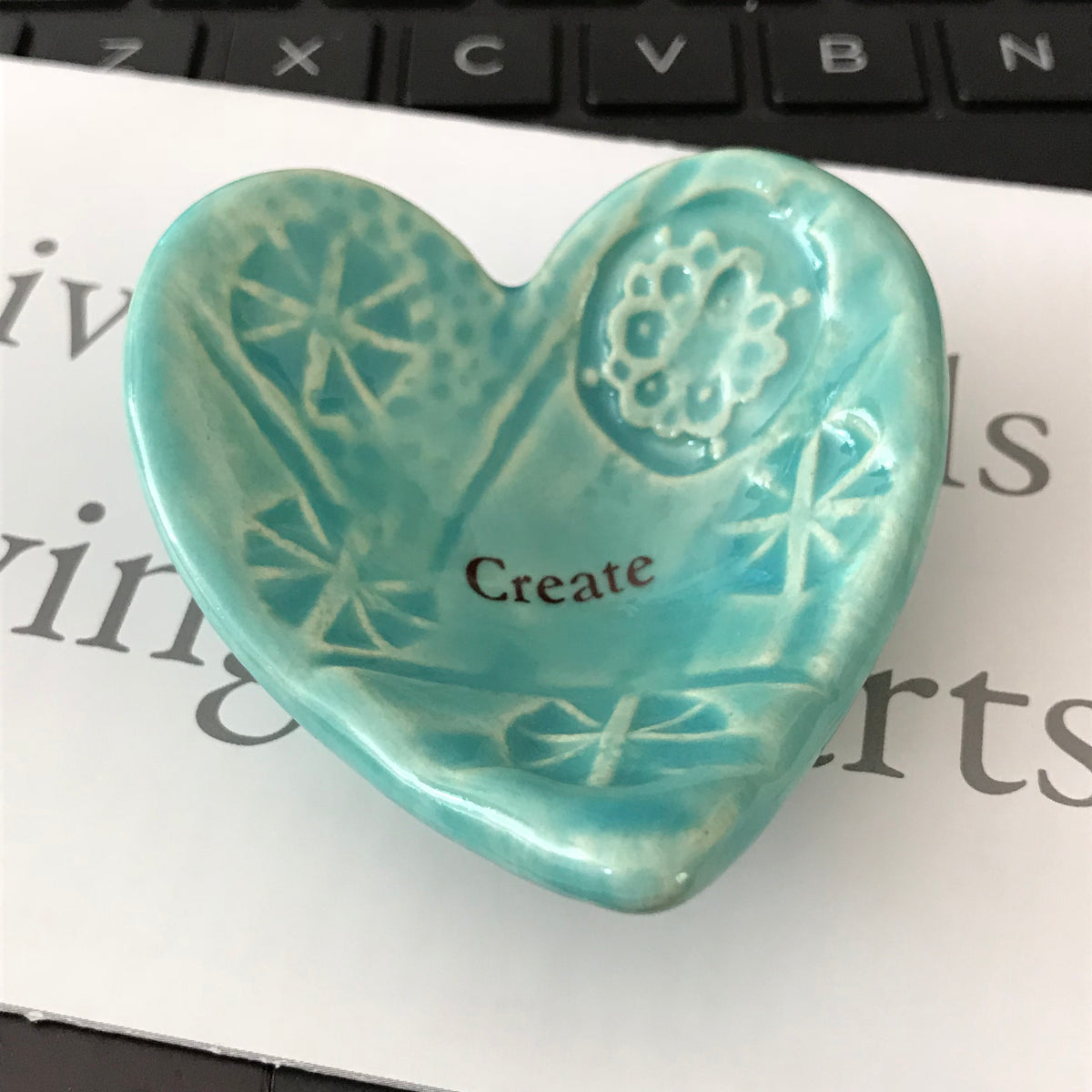 "Giving Heart with the word ""Create""  is a thoughtful gift for anyone who is trying something new.  Shown in turquoise glaze.  Handmade ceramic."