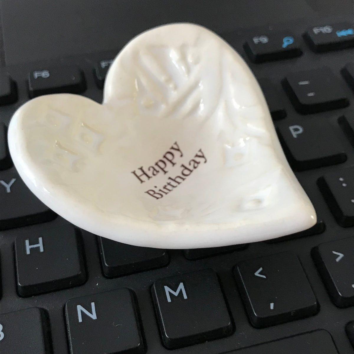 "Here's a wonderful birthday gift for her.  A Giving Heart inscribed with the words ""Happy Birthday"".  Most people use it as a ring dish."