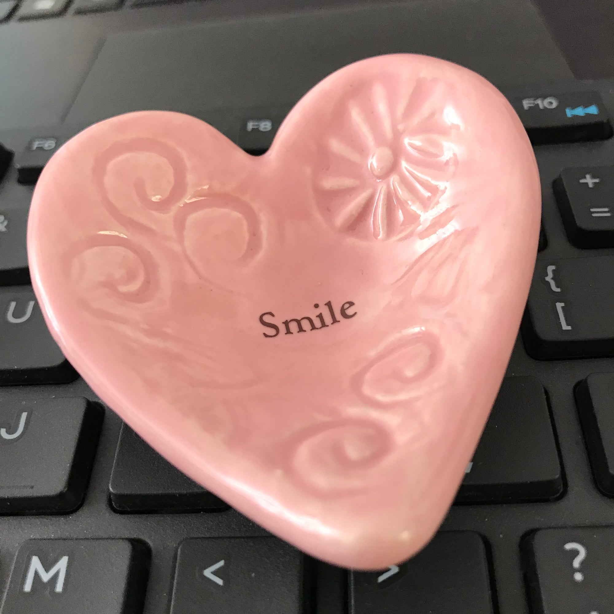 "Imprinted with the word ""Smile"", a Giving Heart sends a positive message."