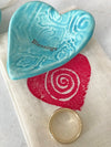 Giving Hearts Gift Bags are hand screened with a red spiral heart design by Lorraine Oerth.