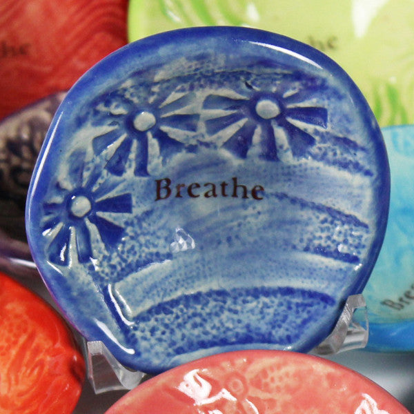 "Giving bowl with the word ""Breathe"" glazed in cobalt blue by Lorraine Oerth studio."