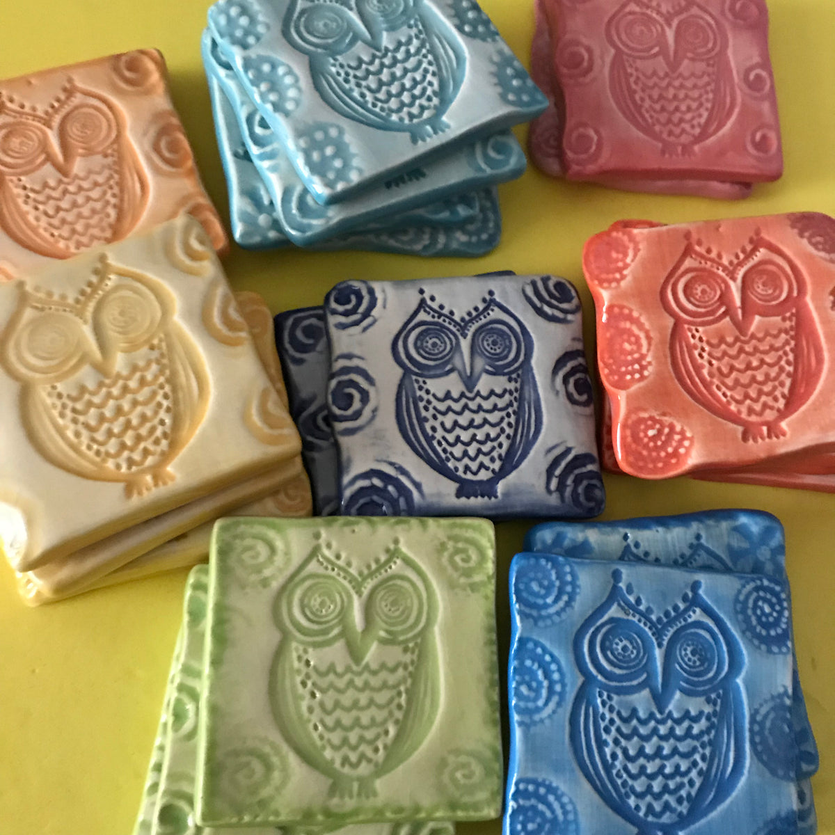 "Our Owl Magnets have a unique design which was created by Lorraine Oerth.  Each magnet is 2 x 2"", crafted from potter's clay, and comes in a variety of bright colors."