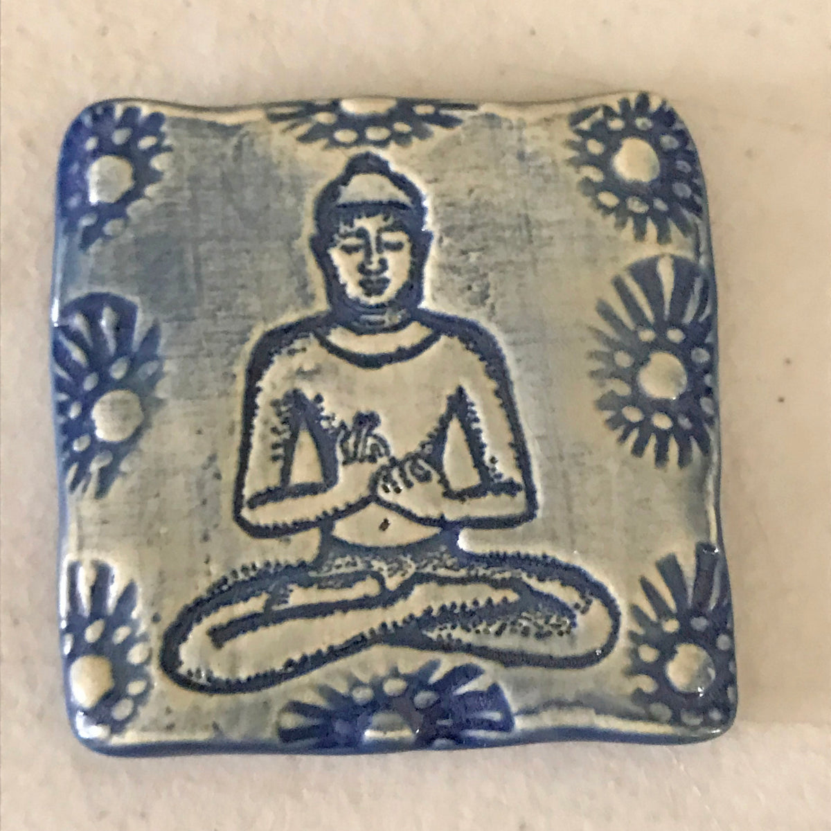Magnet with Buddha image.  Handmade and created by the artisans of Oerth Studio.