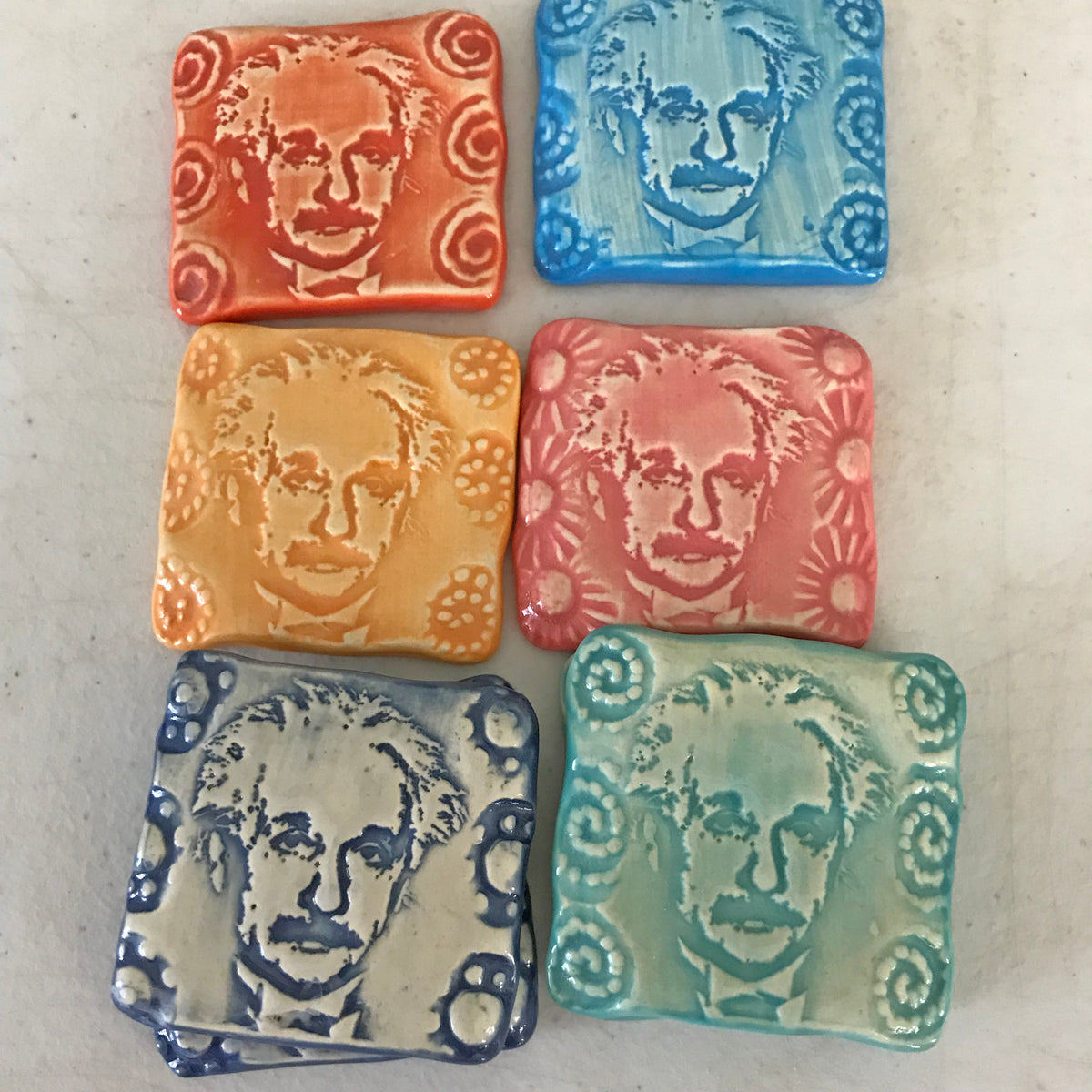 Handmade ceramic magnet with Albert Einstein's portrait embossed in the clay.  A unique process created by the potters of Oerth Studio.