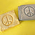 Handmade pottery Peace Sign magnet.