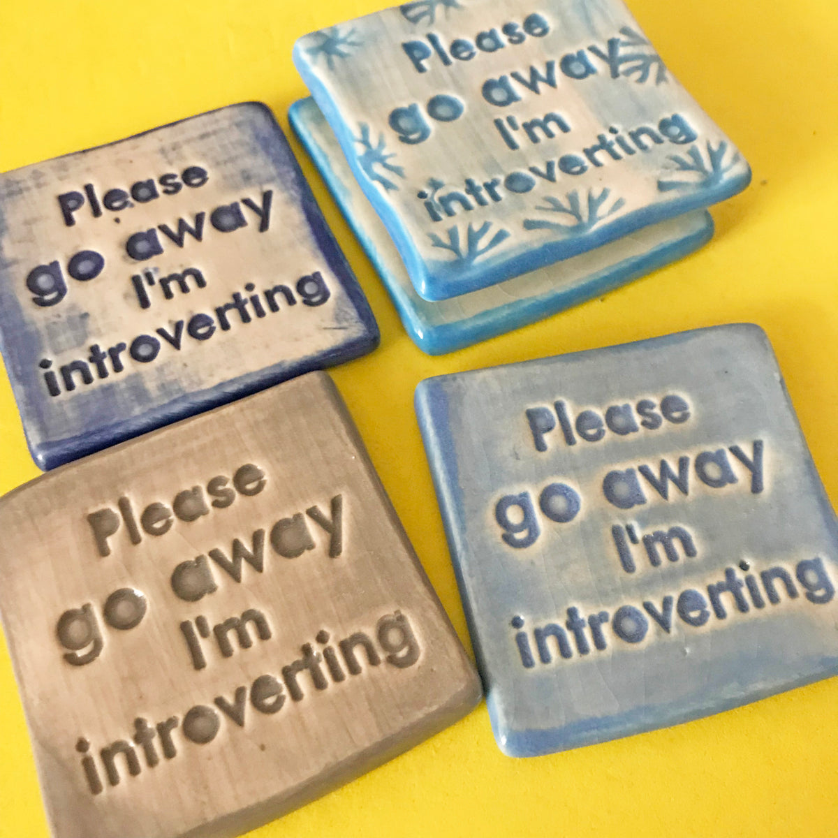 "Attention introverts, this magnet is for you.  It says, ""Please go away I'm introverting""."