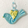 Petite and adorable handmade bird ornament glazed in blue and yellow.