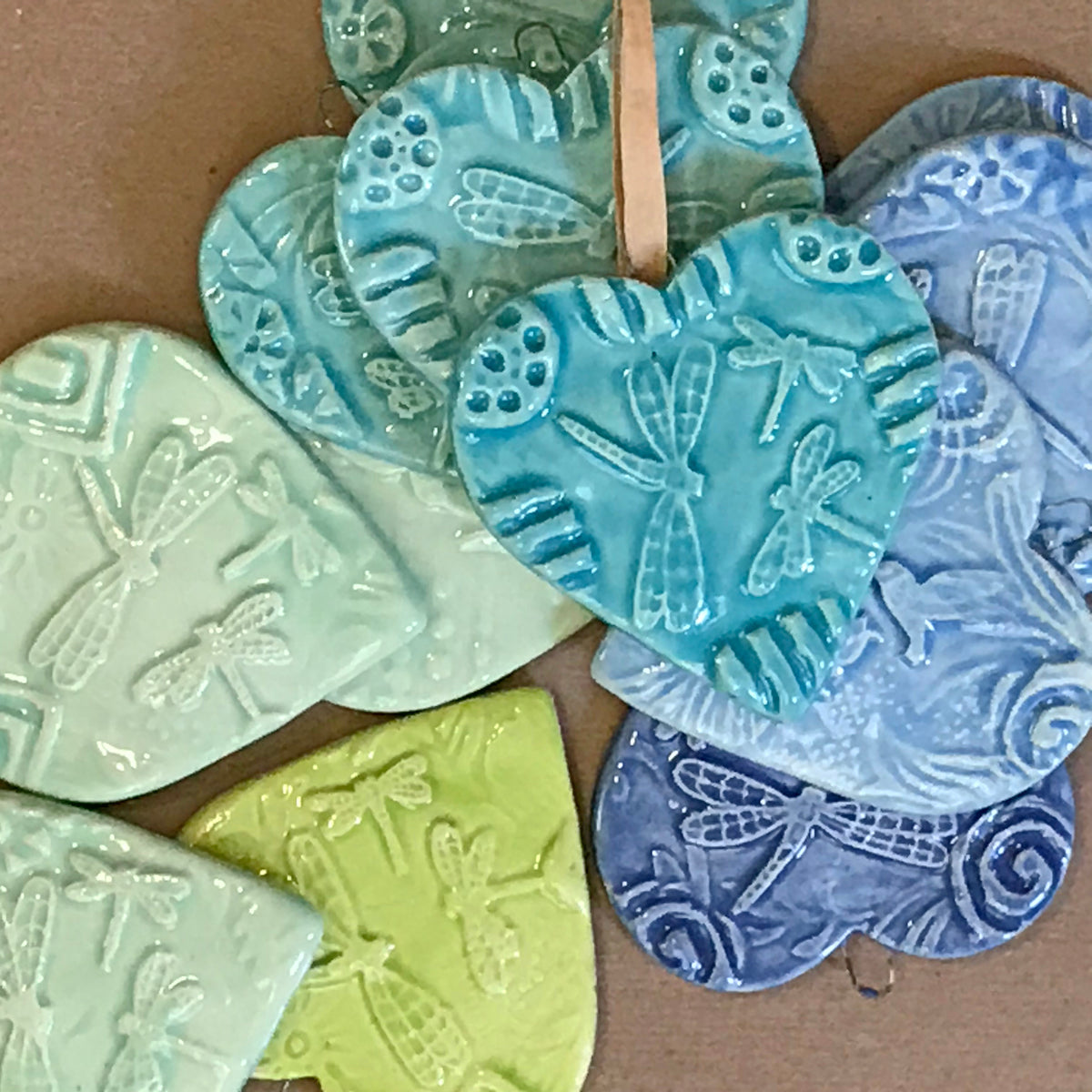 Showing the colors of our dragonfly heart-shaped ornamanets.
