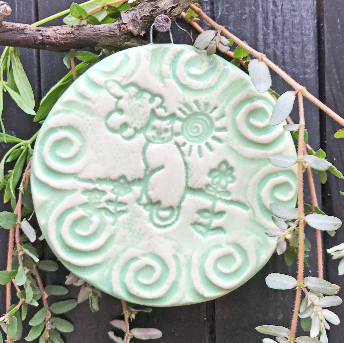 The Spa Green glaze is subtle but pools into the drawing of our Cat in the Sun Ornament.  This color, often called Celadon Green is prized on pre-renaissance porcelain ceramics of Korea and China.