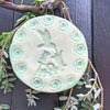 Hummingbird Ornament glazed in a spa green color that is traditionally called celadon green.