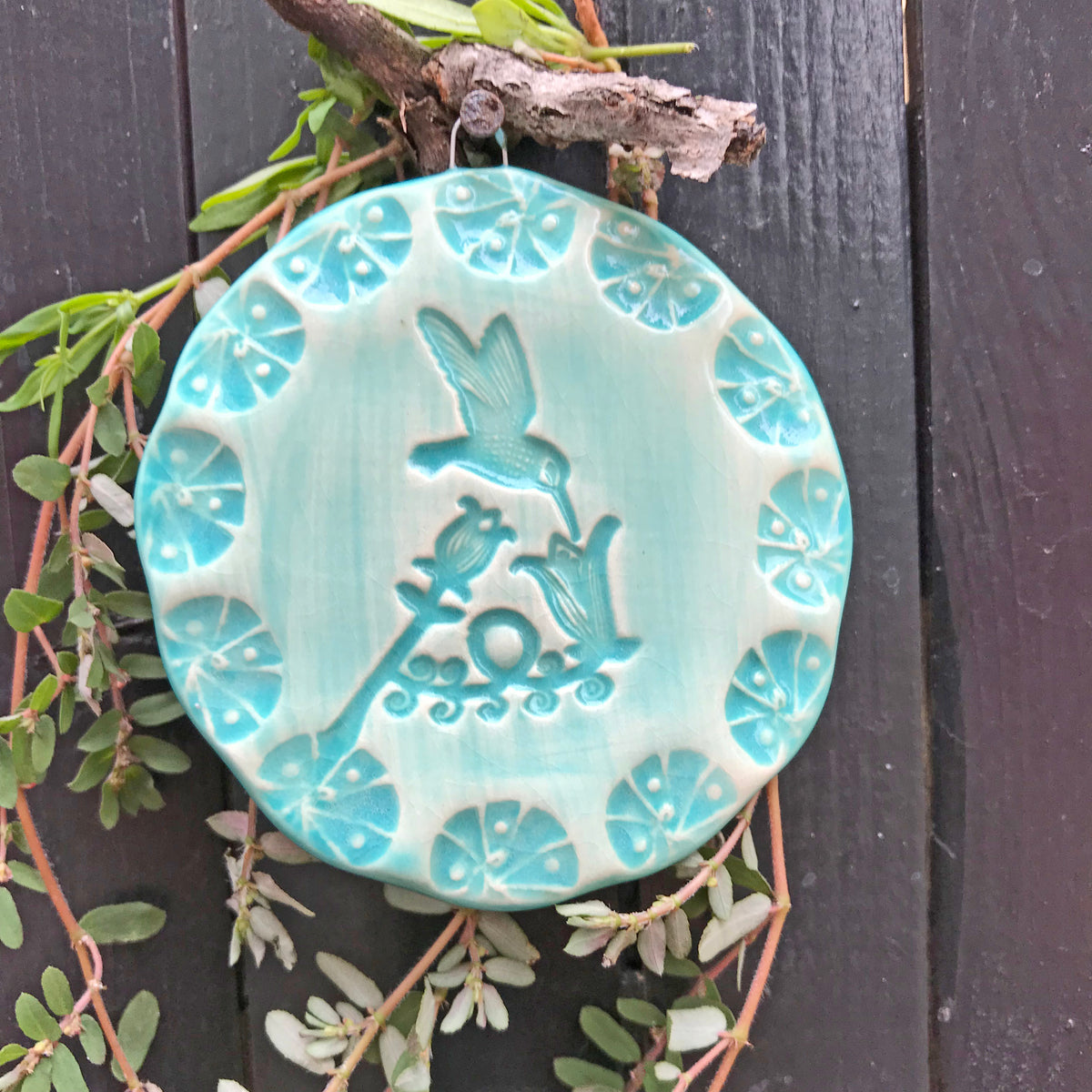 Hummingbird Ornament, handmade by Oerth Studio artisans and glazed in rich turquoise color.