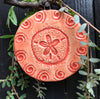 Sand Dollar Ornament in beautiful coral glaze.  A thoughtful gift for beach lovers and nature lovers.