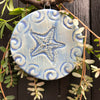 Beautiful nautical blue glaze accentuates the detail of our handmade Starfish Ornament.  Makes a great gift for Christmas or year round.