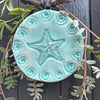 Our starfish ornament, glazed in turquoise blue, looks wonderful on the Christmas Tree but also serves as a year round decoration.  Each varies.