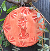 Mermaid Ornament created by the potters of Oerth Studio has a hand drawn mermaid glazed in bright coral orange. al coral.  So pretty against the green of a Christmas Tree.