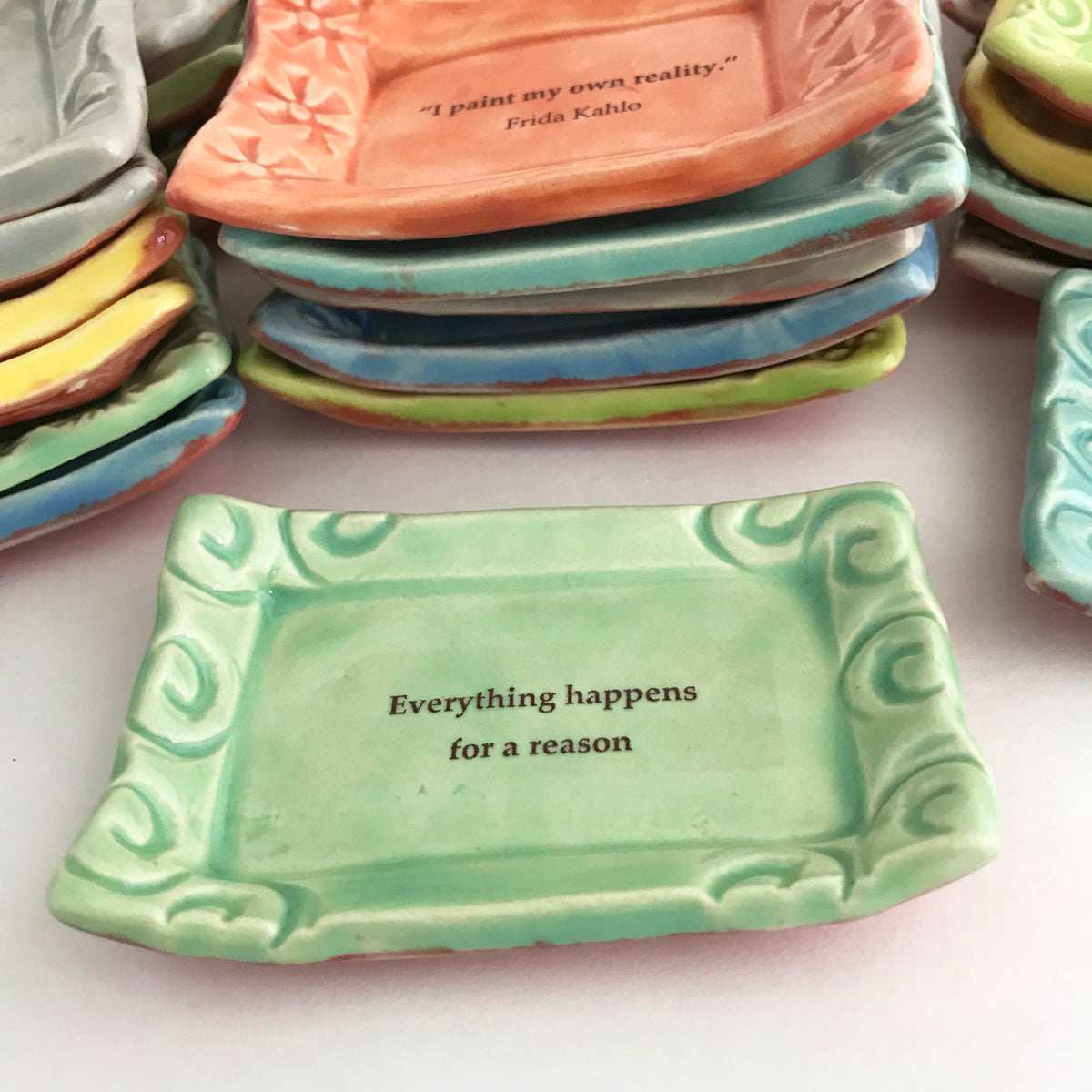 """Everything happens for a reason"" quote on handmade ceramic dish."