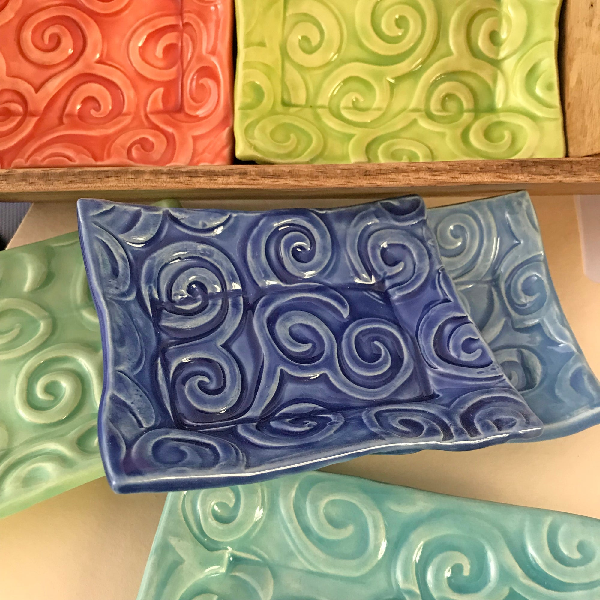 Spiral designs repeat randomly on our deeply embossed ceramic trays.  Very unique and Intriguing design.