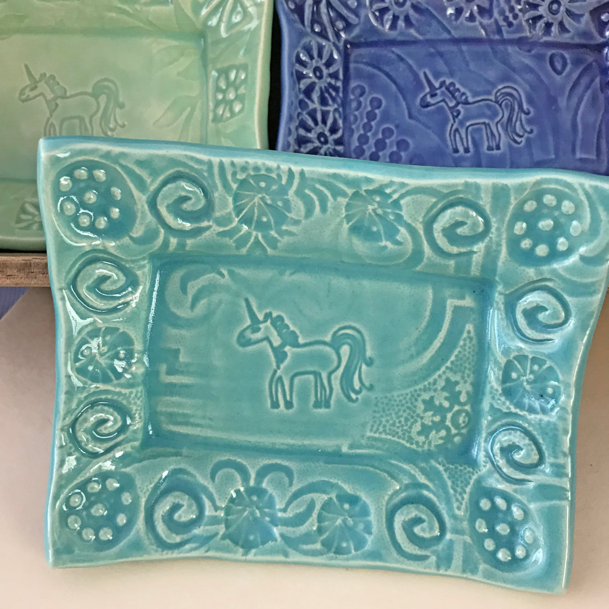 Unicorn Dishes designed for collectors.  Inspired by unicorn images from ancient times, including roman coins, Christian symbolism and manuscripts.  Handmade ceramic.
