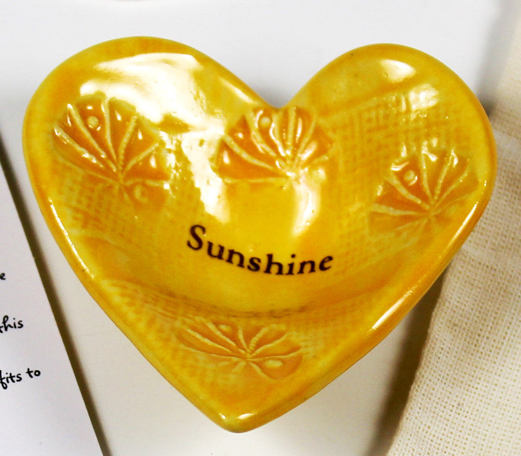 Giving Heart with the word Sunshine glazed in yellow.  Crafted by hand.