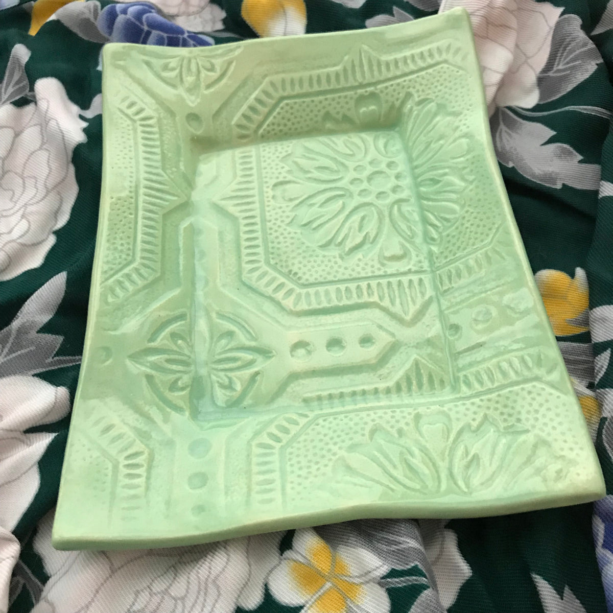 Our 5 x 7 inch handmade tray in beautiful spa green is a totally functional food tray.  Food, dishwasher and microwave safe.  The design is deeply embossed with a contemporary flair.