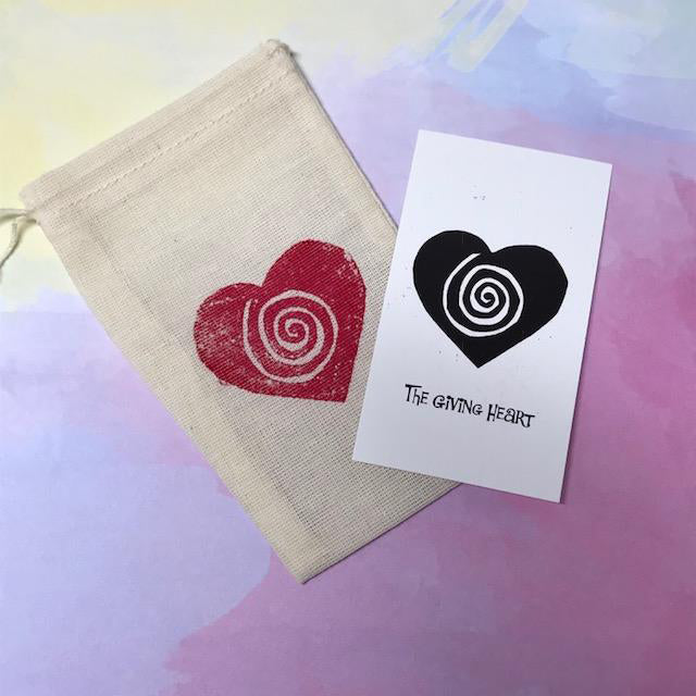 A Giving Heart gift bag is hand screened by us with our logo showing a spiral and heart.