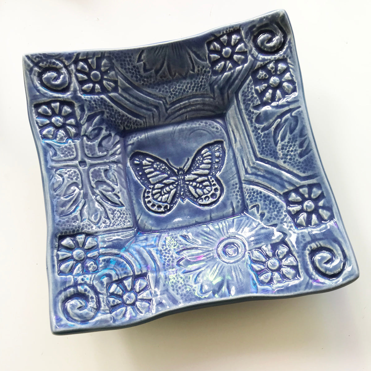 Butterfly design pottery dish handmade by Lorraine Oerth.