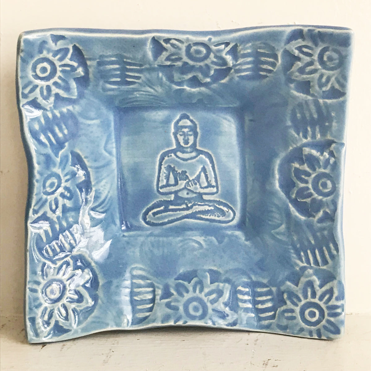 Ceramic Buddha dish glazed in blue grey.