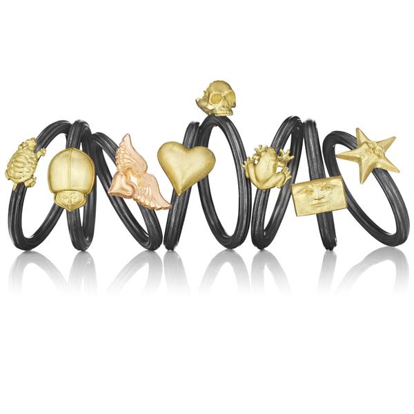 Fine jewelry designer Anthony Lent 18k gold stacking rings with sculpted skull, star, frog, heart and beetle shape