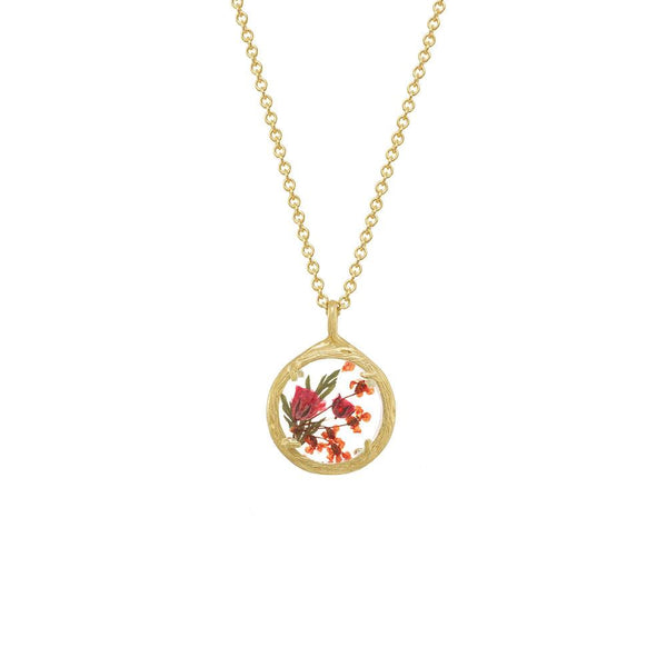 Real pressed plant jewelry in the victorian tradition of designating flowers with symbolism and meaning