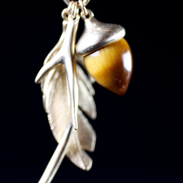 14k gold feather and acorn necklace hand made by fine jewelry designer Annette Ferdinandsen