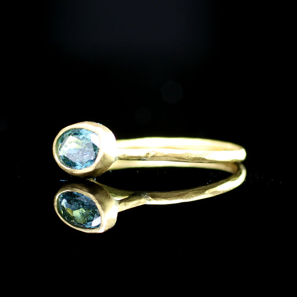 One of a kind blue topaz stacking ring hand made by Margery Hirschey fine jewelry designer