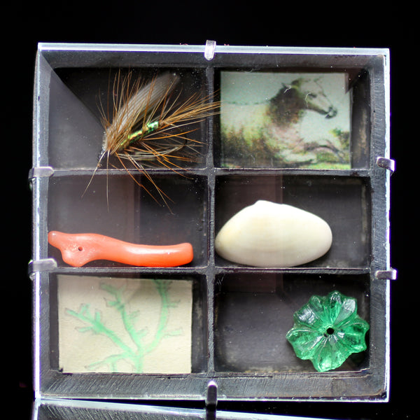 Vintage objects in curiosity box hand made by jewelry designer Grainne Morton