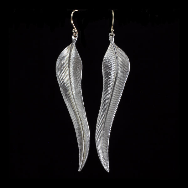 Smooth feather earrings by designer Annette Ferdinandsen hand crafts wearable art in her New York studio inspired by forms in nature- using only fine metals and natural stones she creates limited and one-of-a-kind pieces for wear to special events or everyday.