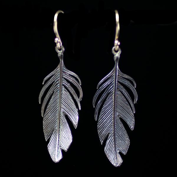 Sterling silver feather earrings hand made by fine jewelry designer Annette Ferdinandsen