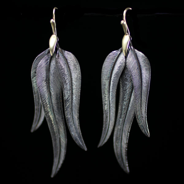 Bird of Paradise feather earrings made from sterling silver by fine jewelry designer Annette Ferdinandsen