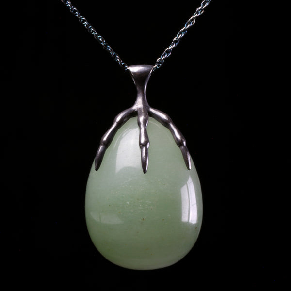 Sterling silver claw clutching carved aventurine stone quail egg pendant hand made by fine jewelry designer Annette Ferdinandsen