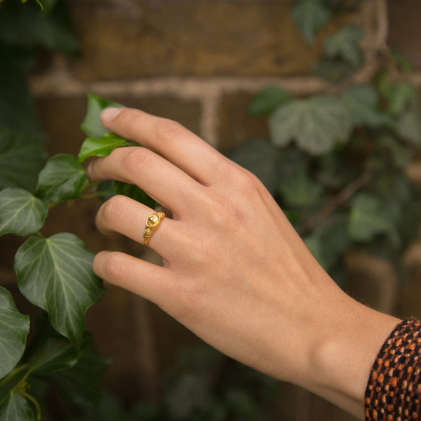 Nature based gold jewelry from British Designer Alex Monroe featuring bees and flowers