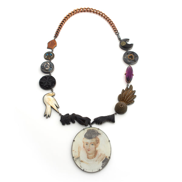 Jewelry designer Grainne Morton vintage and antique button and charm necklace with valconite victorian hands and painted cameo