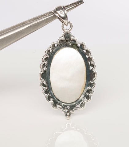 Sterling Silver and Carved Mother-of-Pearl Pendant