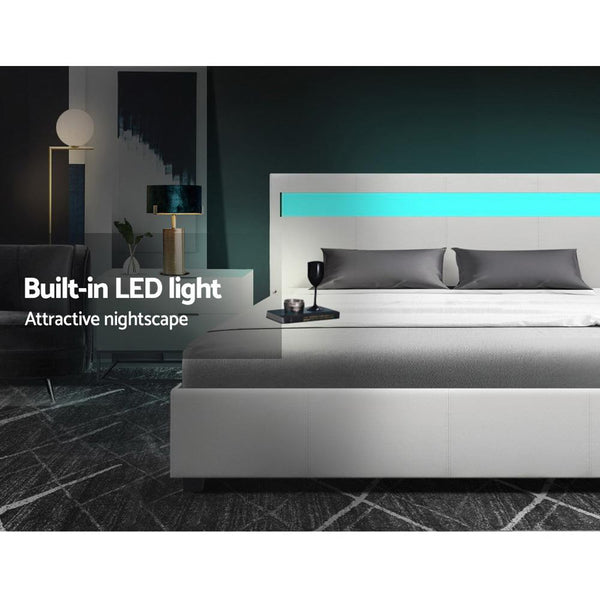 bed with built in LED lighting in white leather