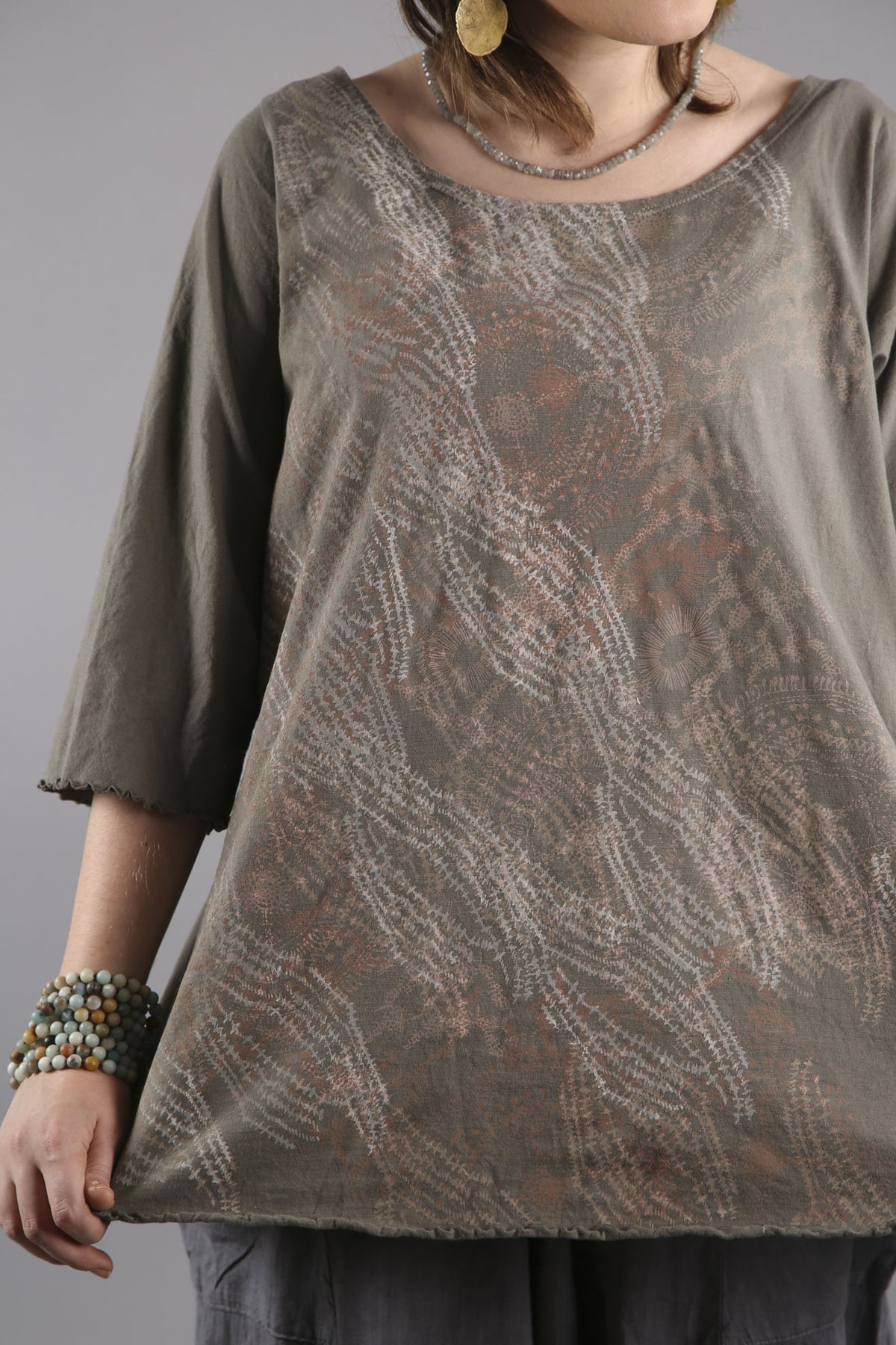 Cafe Tee Sage  with stitched lines in subtle tones print.