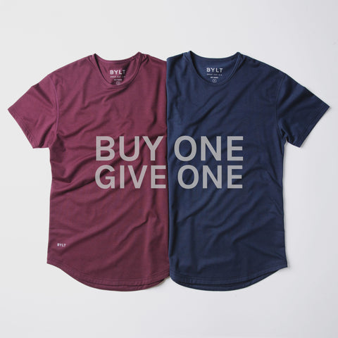 Buy one, give one event showing two shirts