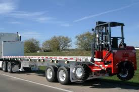 Toronto, ON - Local pickup and delivery (48' flatbed trailer with Moffet forklift Service)