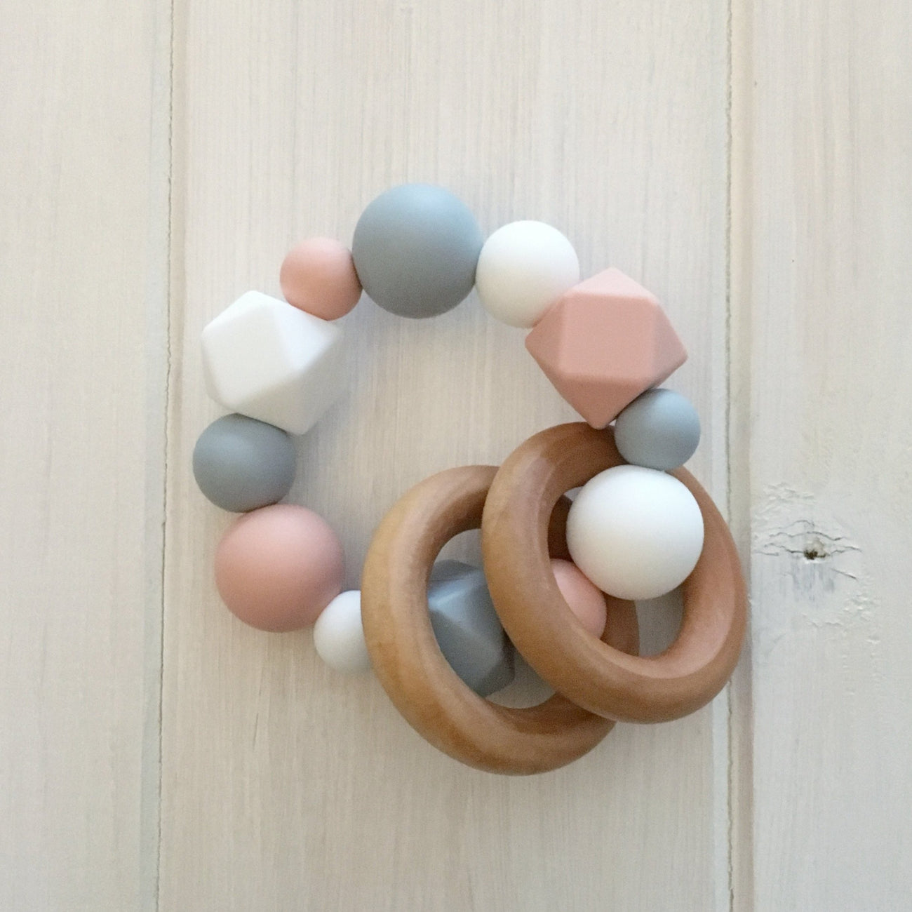 Peach Neutral Silicone Teething Rattle