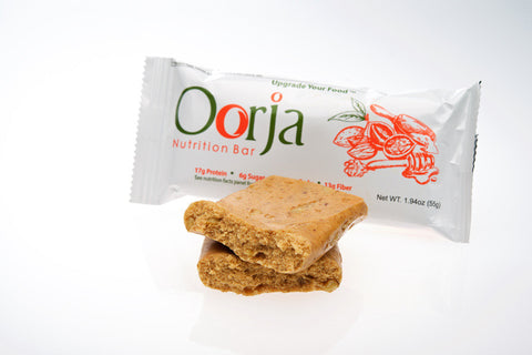 Oorja nutrition bar in a wrapper and open