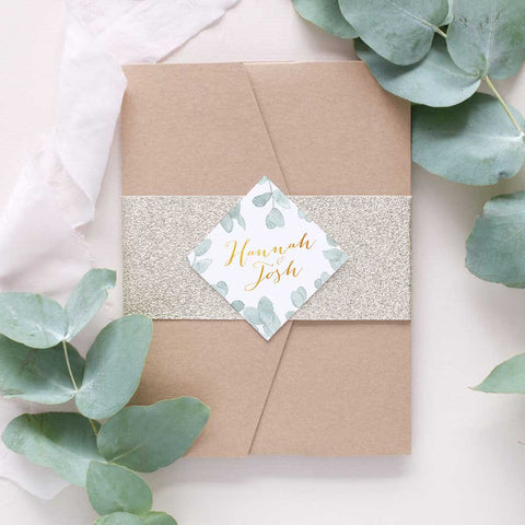 botanical wedding invitation with gold glitter bellyband