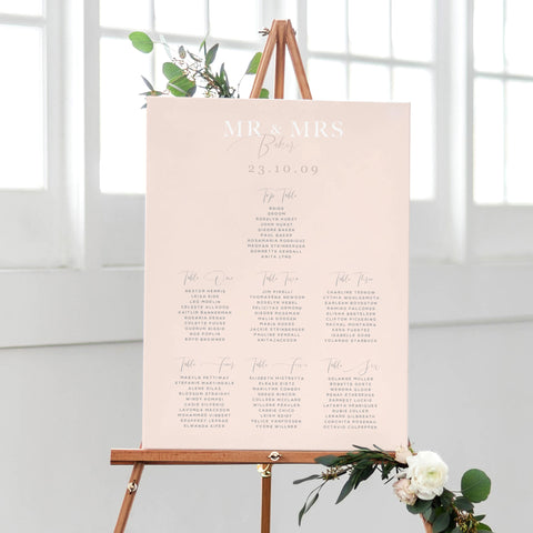 simple blush table plan with calligraphy
