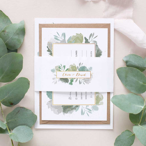green leafy wedding invitation package