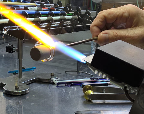 We use blowtorches to make rings and beads individually by hand...
